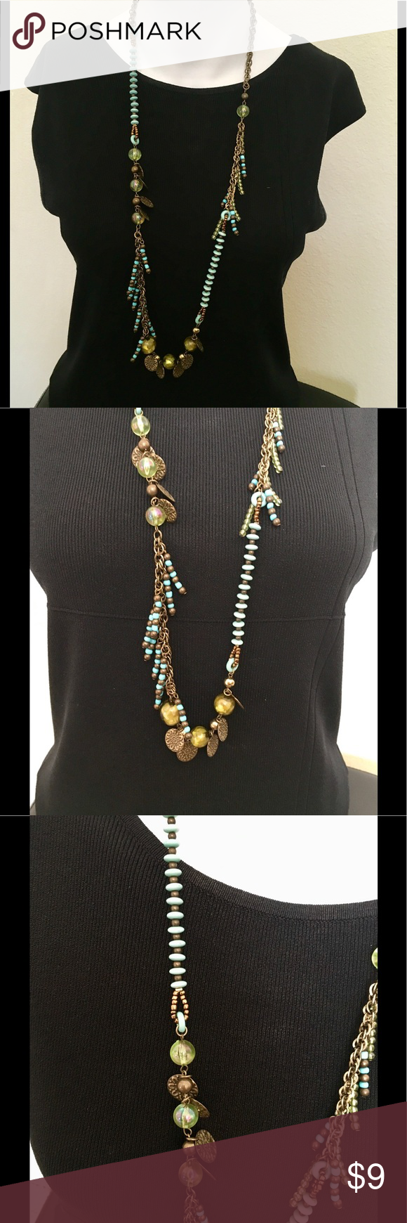 Treska Turquoise & Copper Beaded Necklace This is a fun, casual necklace from Treska. Featured green, turquoise and bronze-colored beads with plastics discs. Wear to work or for a night out! Treska Jewelry Necklaces