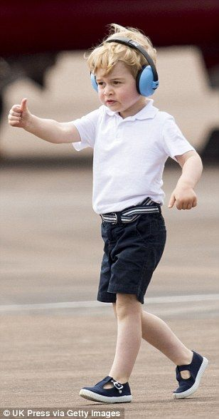 Prince George could be seen giving somebody the thumbs up as he strolled across the airfie...