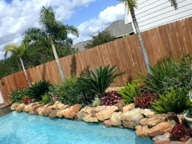 11 Simple Pool Landscaping Ideas That Fit Your Budget is part of Backyard pool landscaping, Tropical backyard landscaping, Simple pool, Pool landscaping plants, Landscaping around pool, Pool landscaping - Want to give your swimming pool a new look that won't break the bank  Use these simple pool landscaping ideas to transform your backyard space