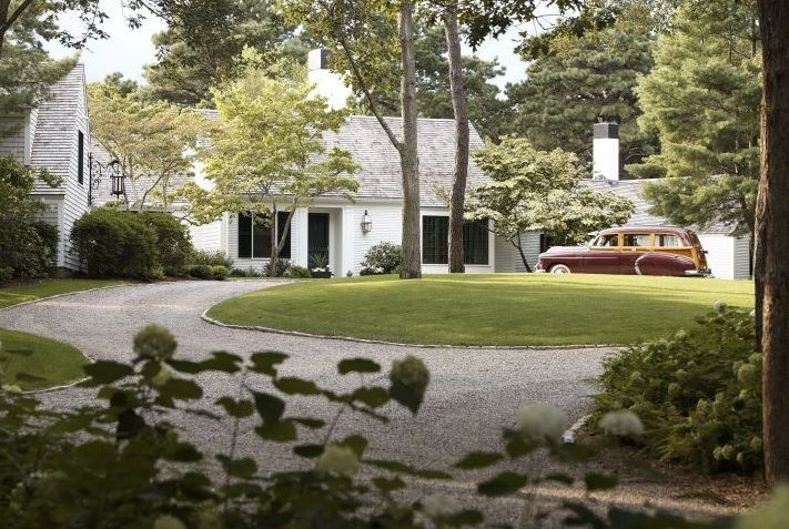 Beautiful crushed slate driveway. Great landscaping and house. Not to mention the antique car-obsessed with old cars