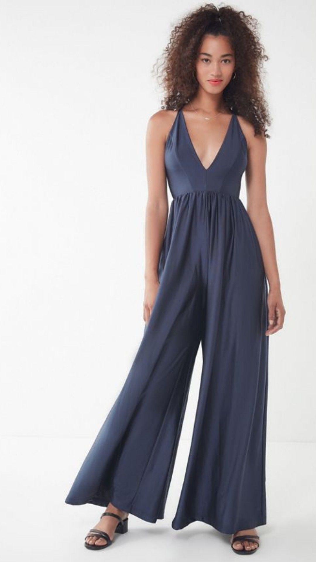 bc492479920b  70s supermodel style in this silky-look plunging jumpsuit from Urban  Outfitters. Built
