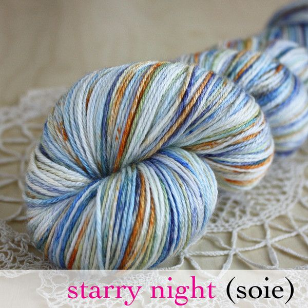 """""""Starry Night,"""" a brand new colourway from Phydeaux Designs, with sky, cobalt and jewel blues, harvest moon orange and mossy green against a snowy white background.  Hand dyed, shown here in Soie, 50/50 sw merino/silk fingering weight.  :)"""