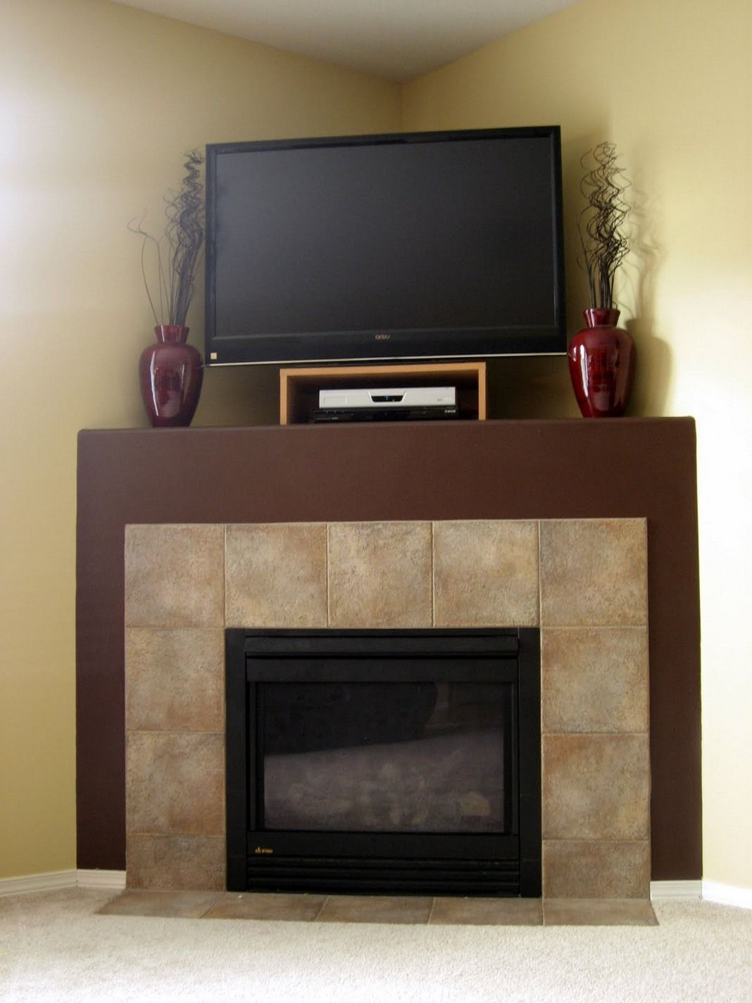 Tv above corner fireplace big slate tile faced House ideas