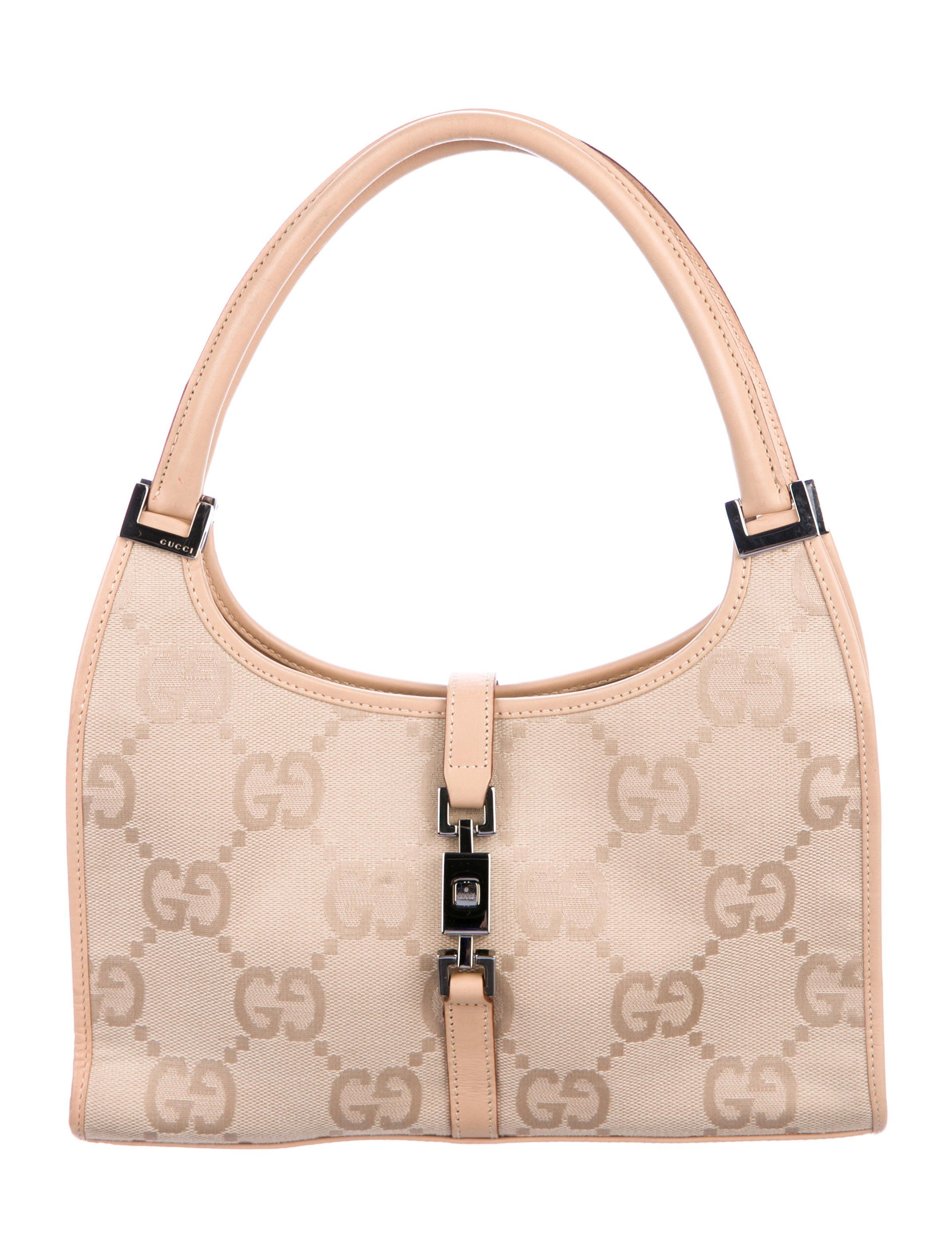 604e1798a17 Beige and tan GG canvas Gucci Jackie tote with silver-tone hardware