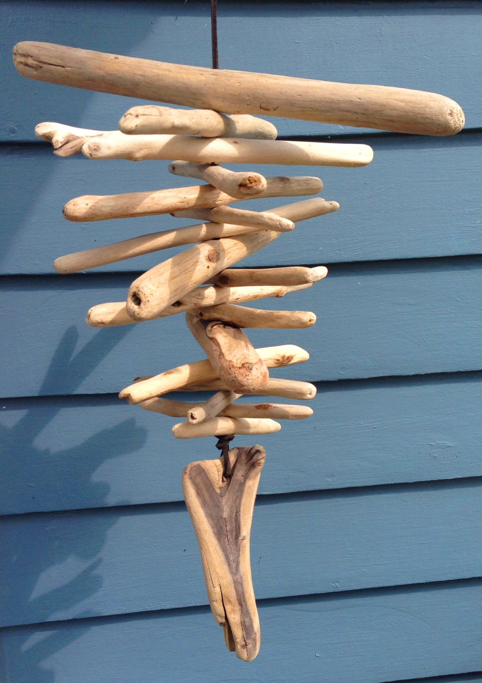 Bring home a piece of the ocean with once of these I love the ocean Driftwood  Wind Chimes (Driftwood Mobile).