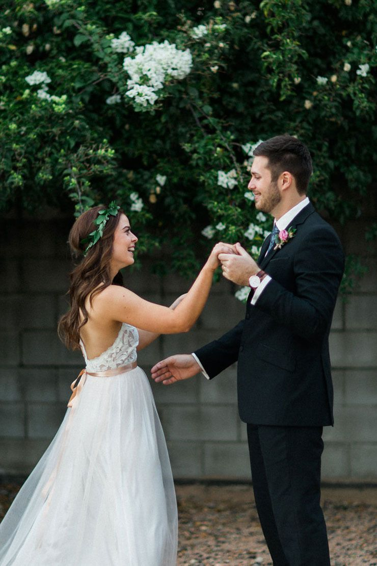 A vintage inspired garden wedding black suits flower crowns and