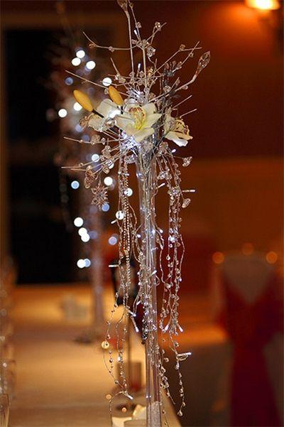 Wedding table centerpieces tall vases sparkle