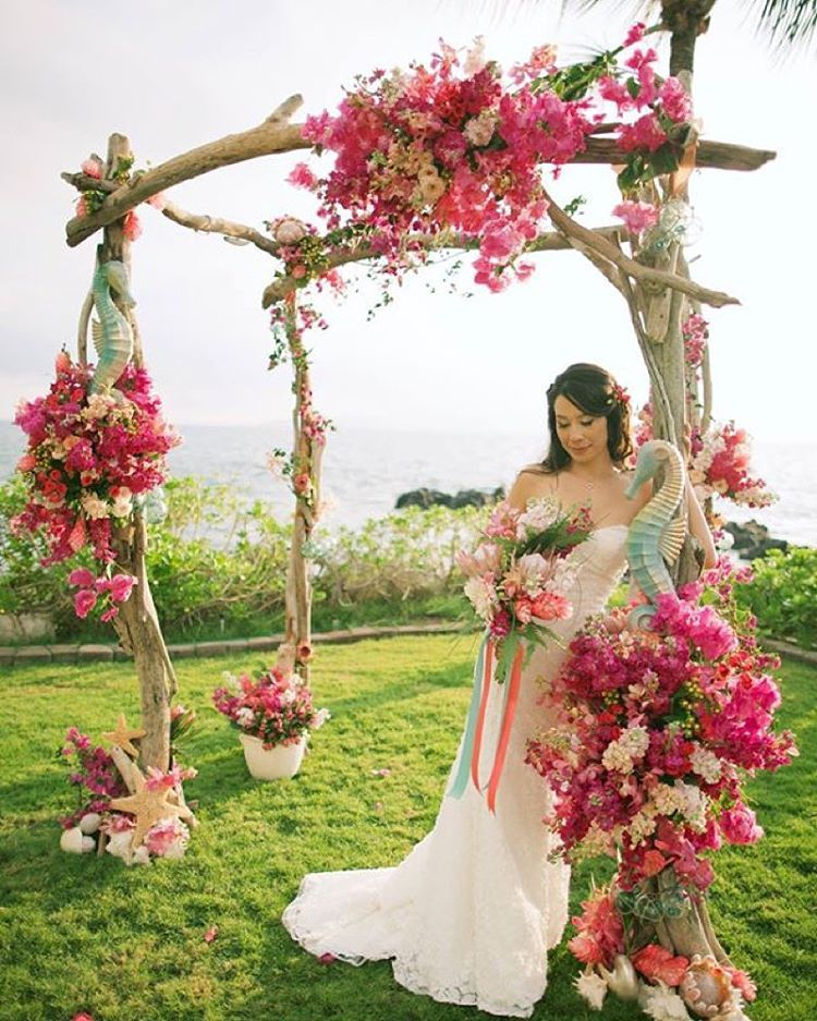 Tropical Dream Wedding Arch dripping with pink florals by Dellables - Anna Kim Photography