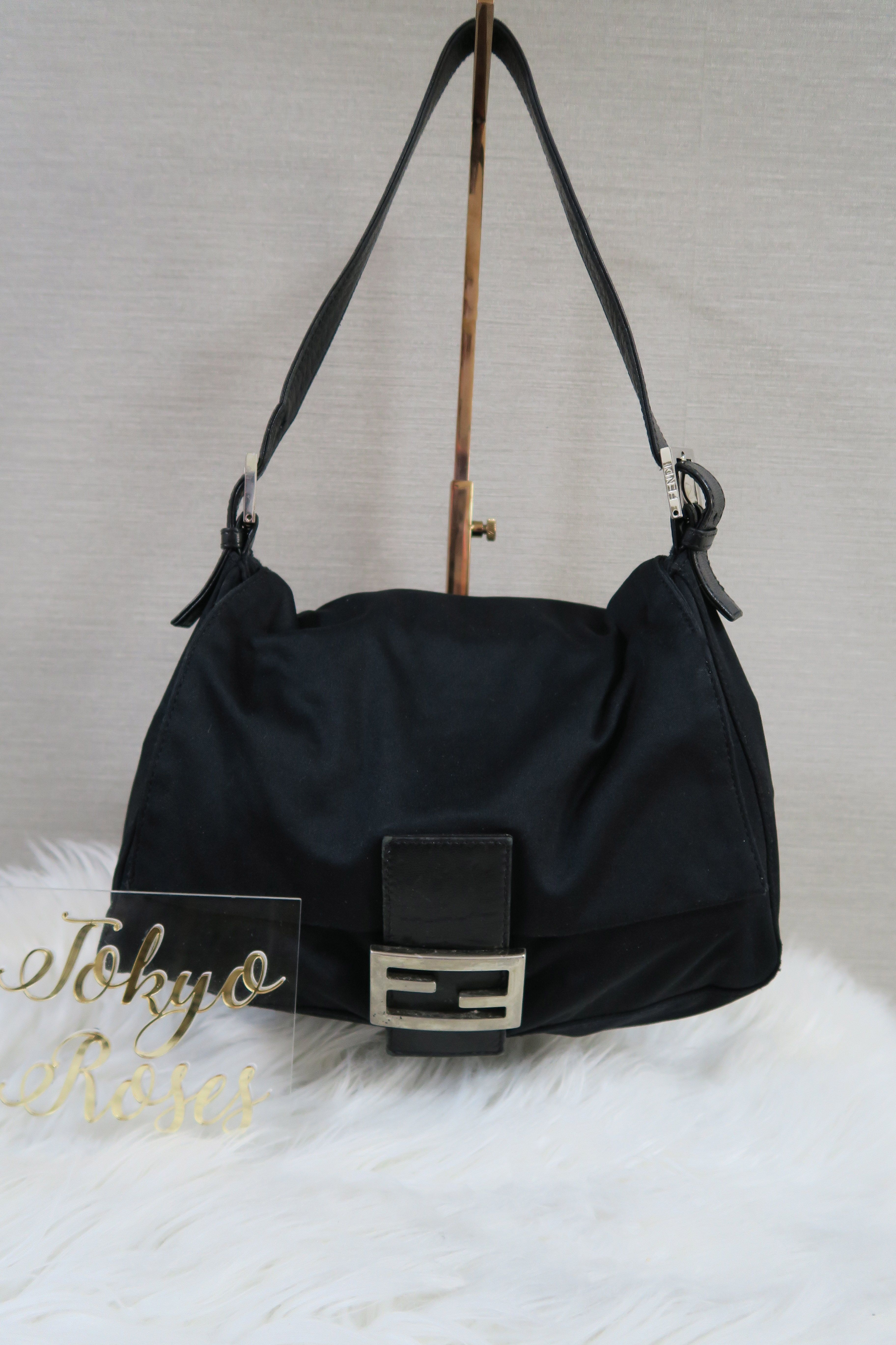 5de78f09d7bd Black Fendi Mama Baguette Handbag L. Find this Pin and more on Vintage  Fendi FF logo Zucca ...