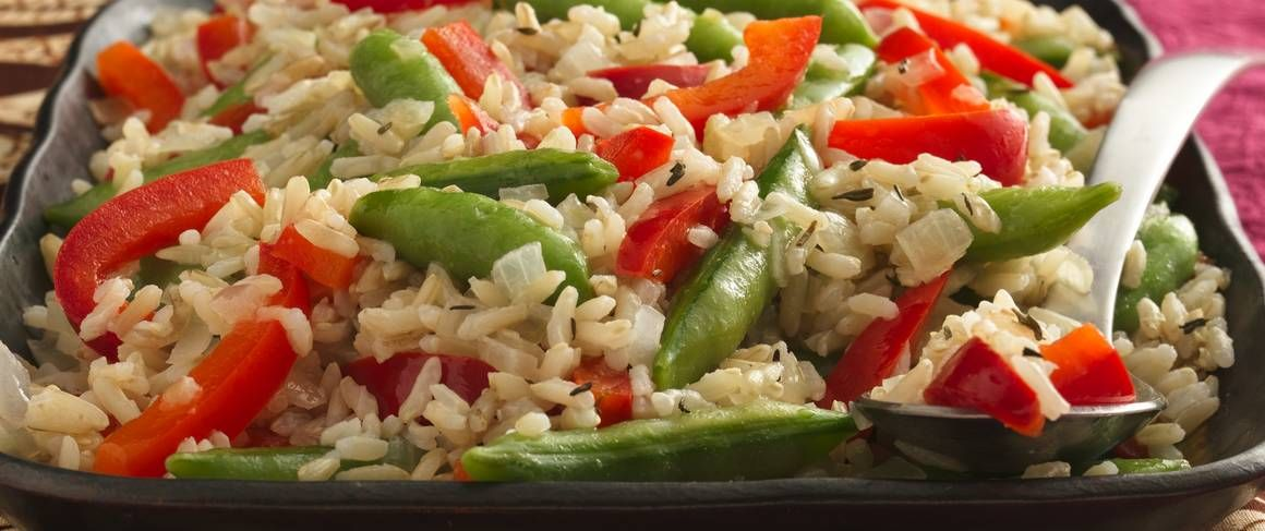 From Betty's Soul Food Collection...  Glam up basic sugar snap peas by sautéing this classic veggie with onion and garlic, then blending in thyme-flavored rice.