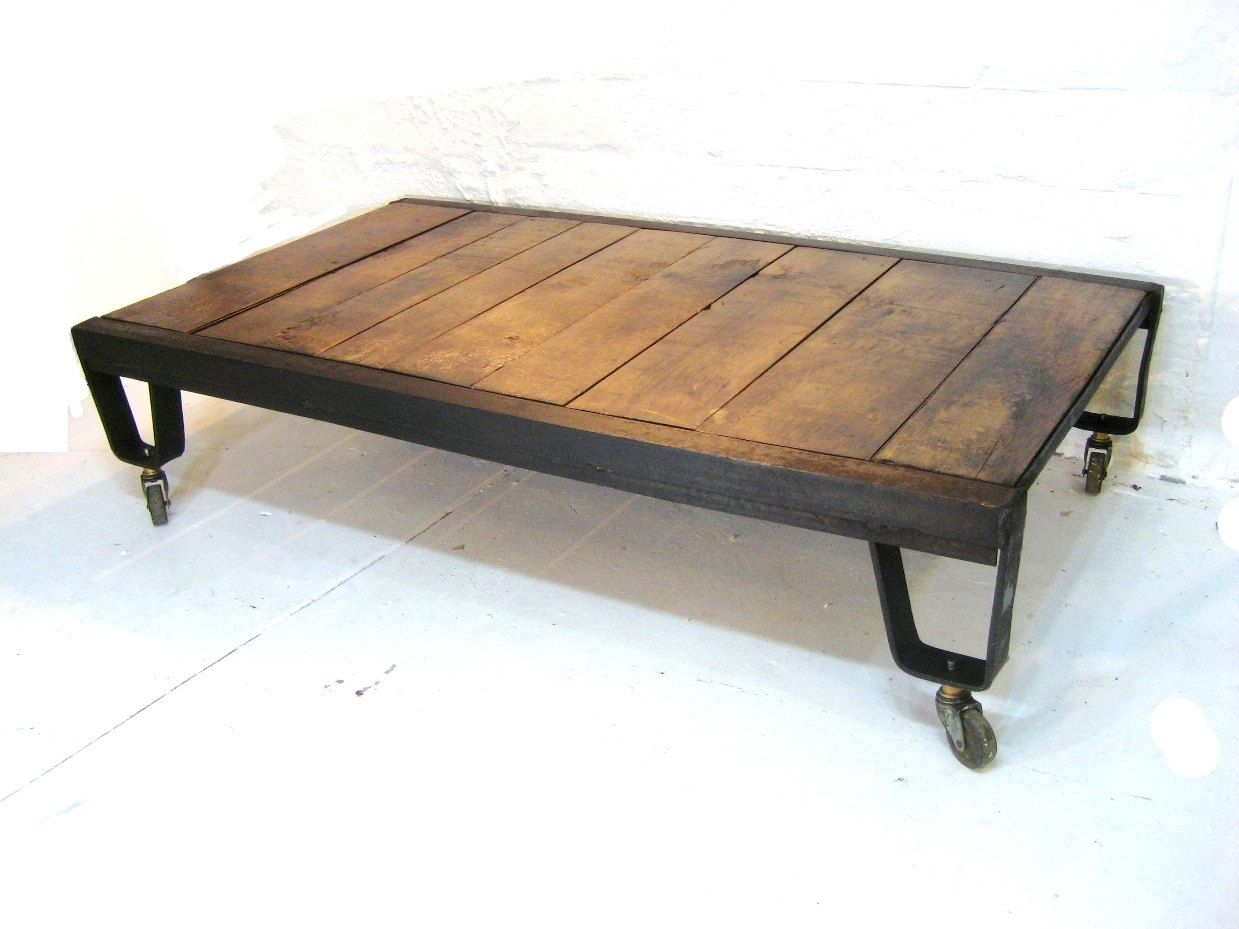 Industrial coffee table natural wood and iron metal vintage industrial coffee table natural wood and iron metal vintage rolling foundry coffee table geotapseo Gallery