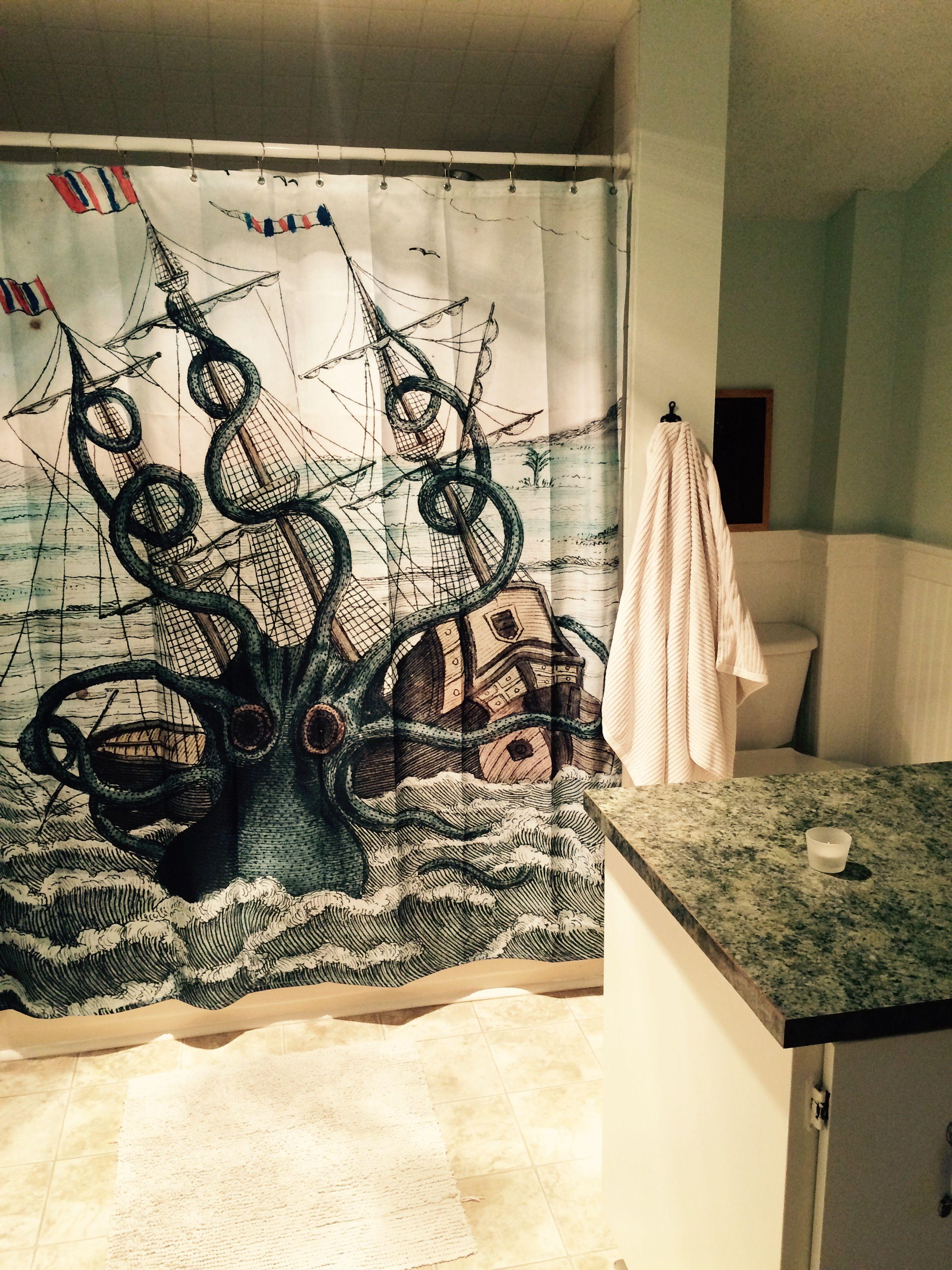 Kraken shower curtain and green walls in bathroom