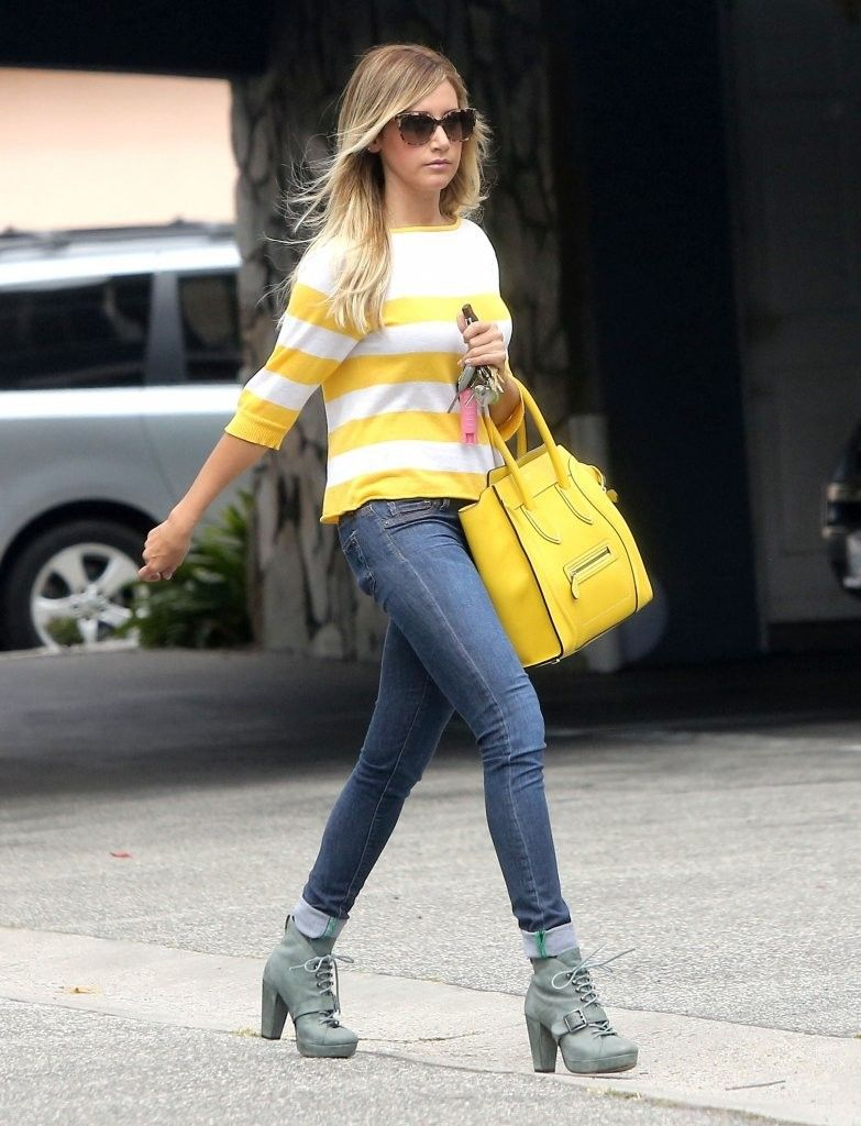 Ashley Tisdale with a yellow Celine tote and yellow and ...