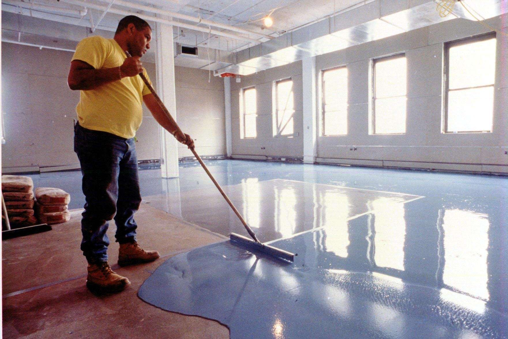 Floor Resurfacer Covers Spalled And Damaged Concrete Floor