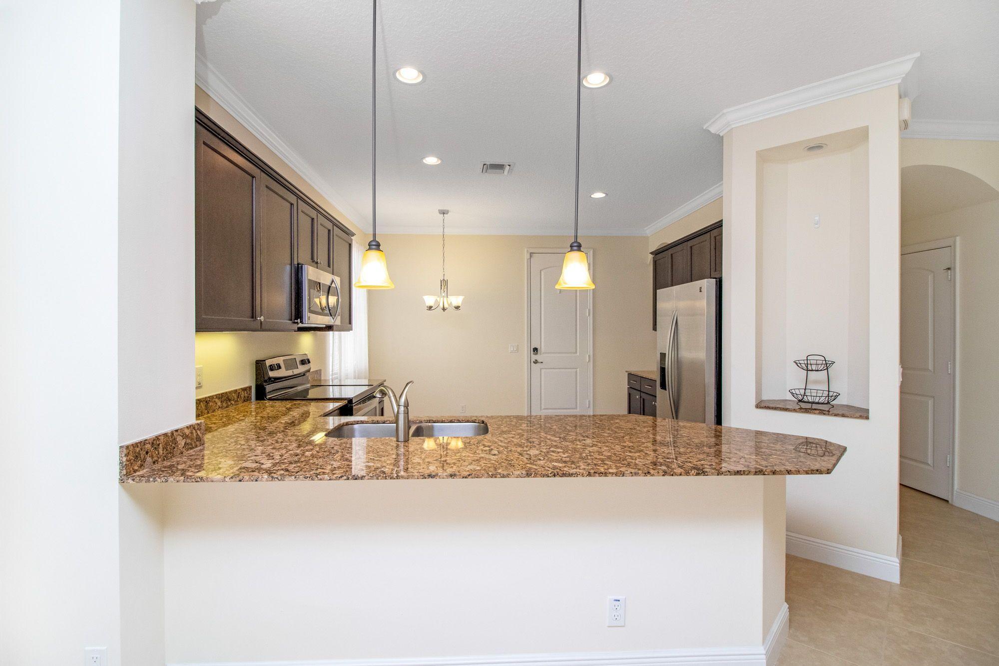2115 Foxtail View Court West Palm Beach Fl In 2020 Granite Countertops Countertops Espresso Kitchen Cabinets