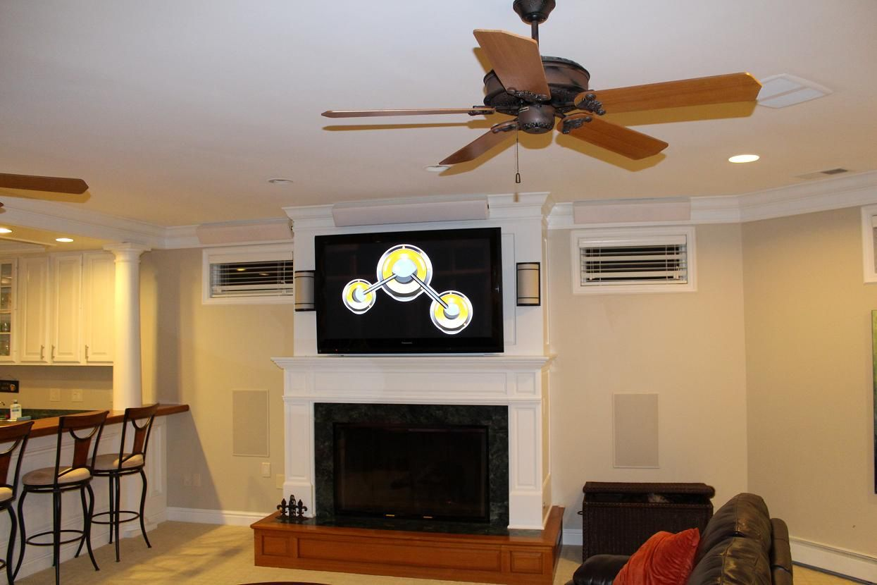 How S This For A Living Room Three Totem Speakers Are Artfully Mounted On The Ceiling Molding While Two Subwoofers Are Mou Wall Mounted Tv Sale Design Tv Wall