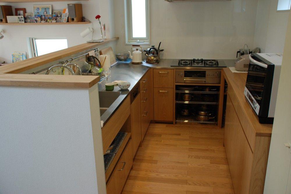 ナラ板目材とステンレスをうまく組み合わせたコの字型キッチン オーダーキッチン L型キッチン リビング キッチン