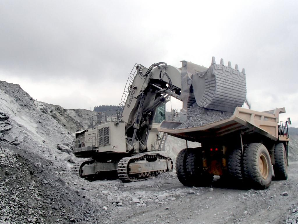This Liebherr mining excavator, equipped with a 15m3 bucket in front shovel configuration, is working in a zinc mine in Southern China. It is a Liebherr R 9250 E type excavator, the E stands for electric here.