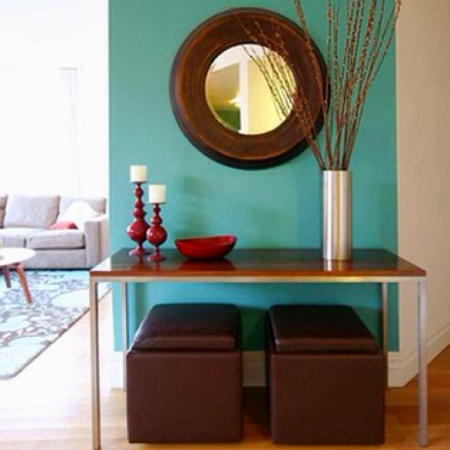 Red And Turquoise Living Room: Teal Against Dark Brown & Red