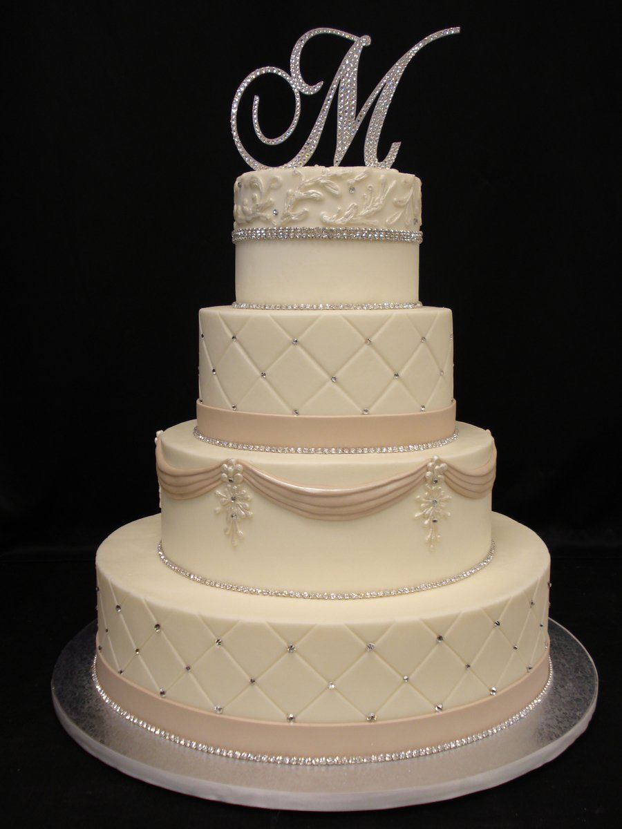 Pearlized blingy buttercream cake with fondant accents piping is
