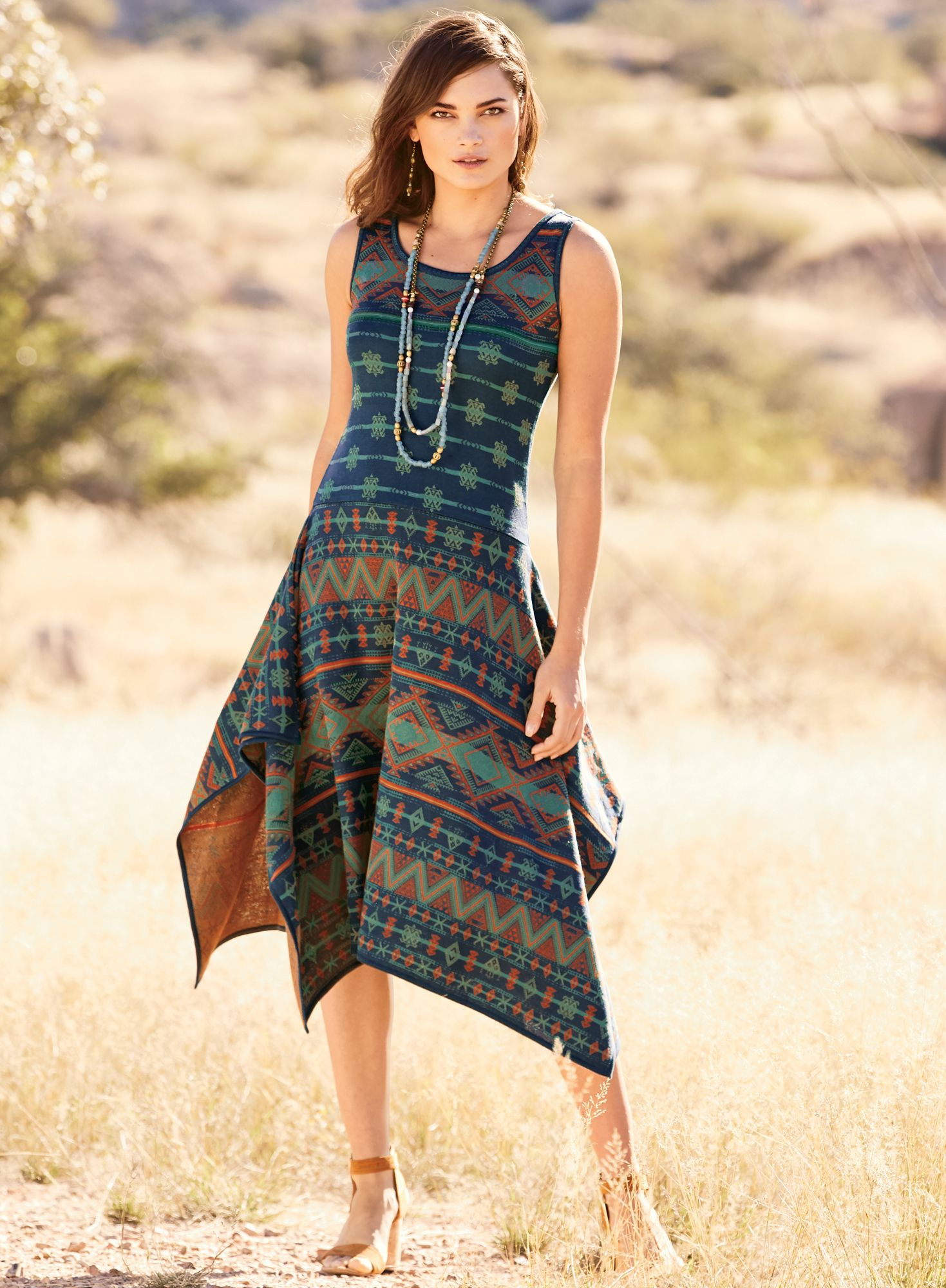 7bb8aa03ebf18 Patterned striping from a vintage Berber rug inspired this head-turning  dress in tangerine,