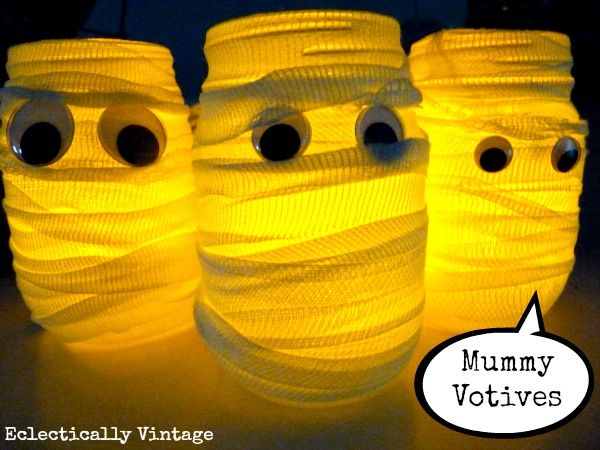 Halloween House Tour - tons of creative #Halloween decorations like these DIY #mummy votives!  eclecticallyvintage.com
