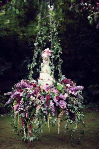 enchanted fairy tale wedding swing with floral wedding cake