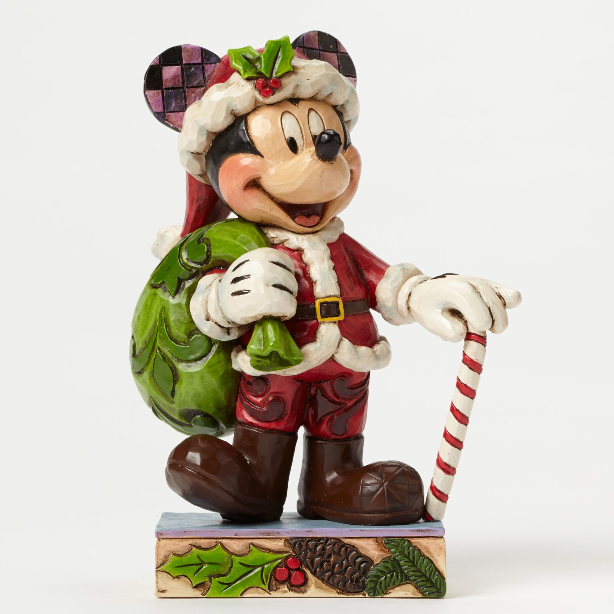 St. Mick stands ready for his big day in this colorful new Personality Pose from the artistry of Jim Shore. Beautifully handcrafted, this smaller size design adds a festive touch of Disney to any holiday display.