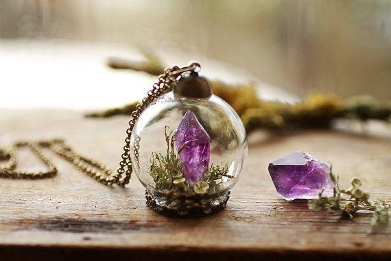 A precious amethyst terrarium necklace.