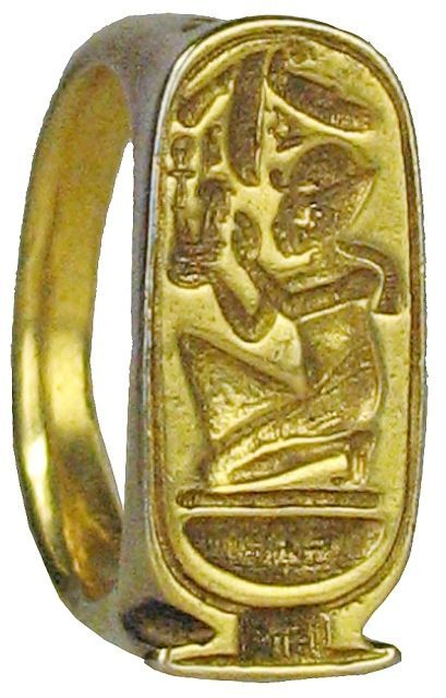 22kt Solid Gold Ring with the image of a kneeling Amun, the Egyptian sky God who came to be regarded as the sun God, (flat headdress, and the Uraeus cobra symbol) paying homage. Inscriptions on the sides. Ptolemaic, approx. 305 BC