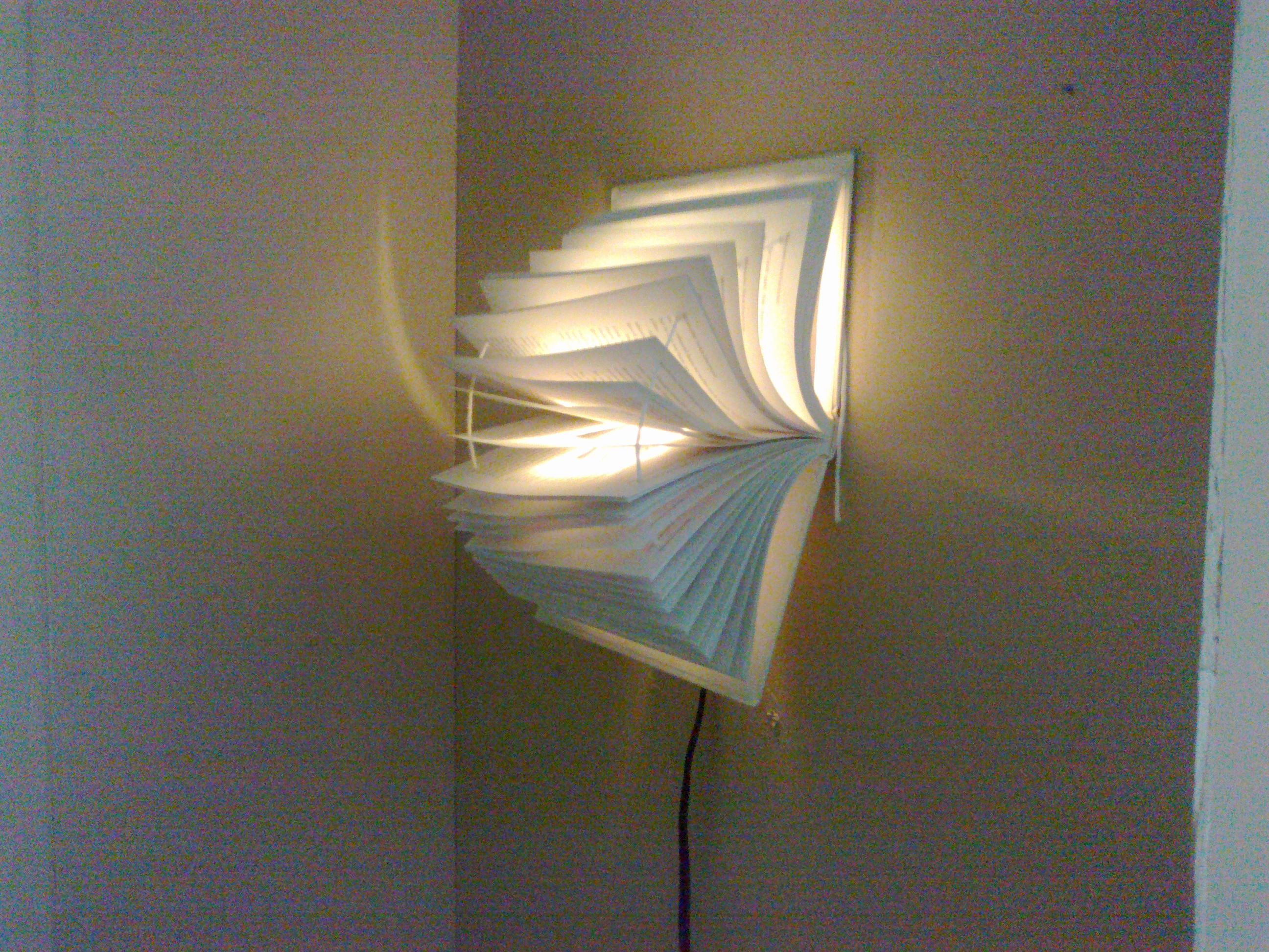 This is a wall lamp i created from a book,actually very easy