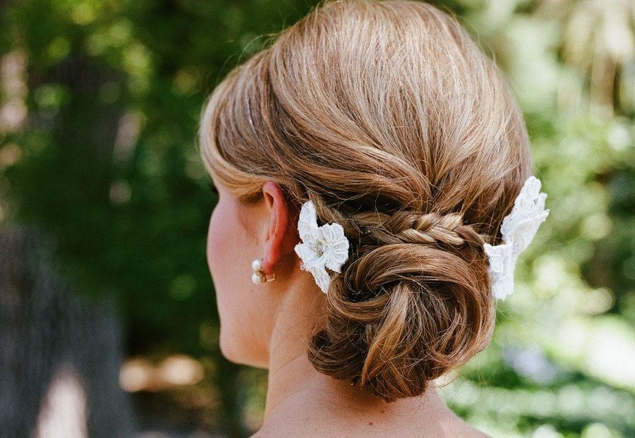Low-twisted-bun-wedding-hairstyle-with-braid.full