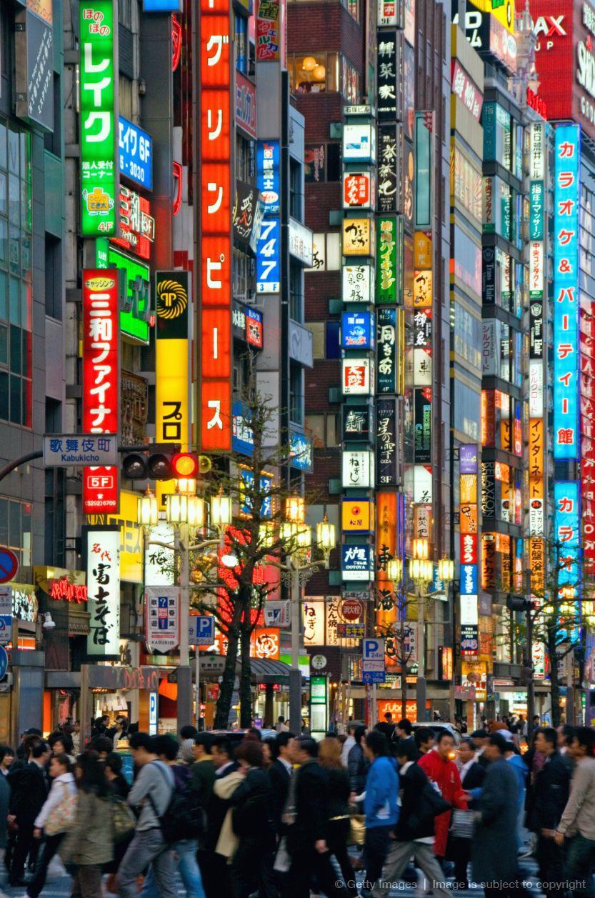 Japanese Street Fashion Trends: Japan, Tokyo, Shinjuku, Neon Advertising Signs In Street
