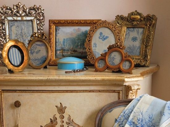 Bits of fabric in ornate frames