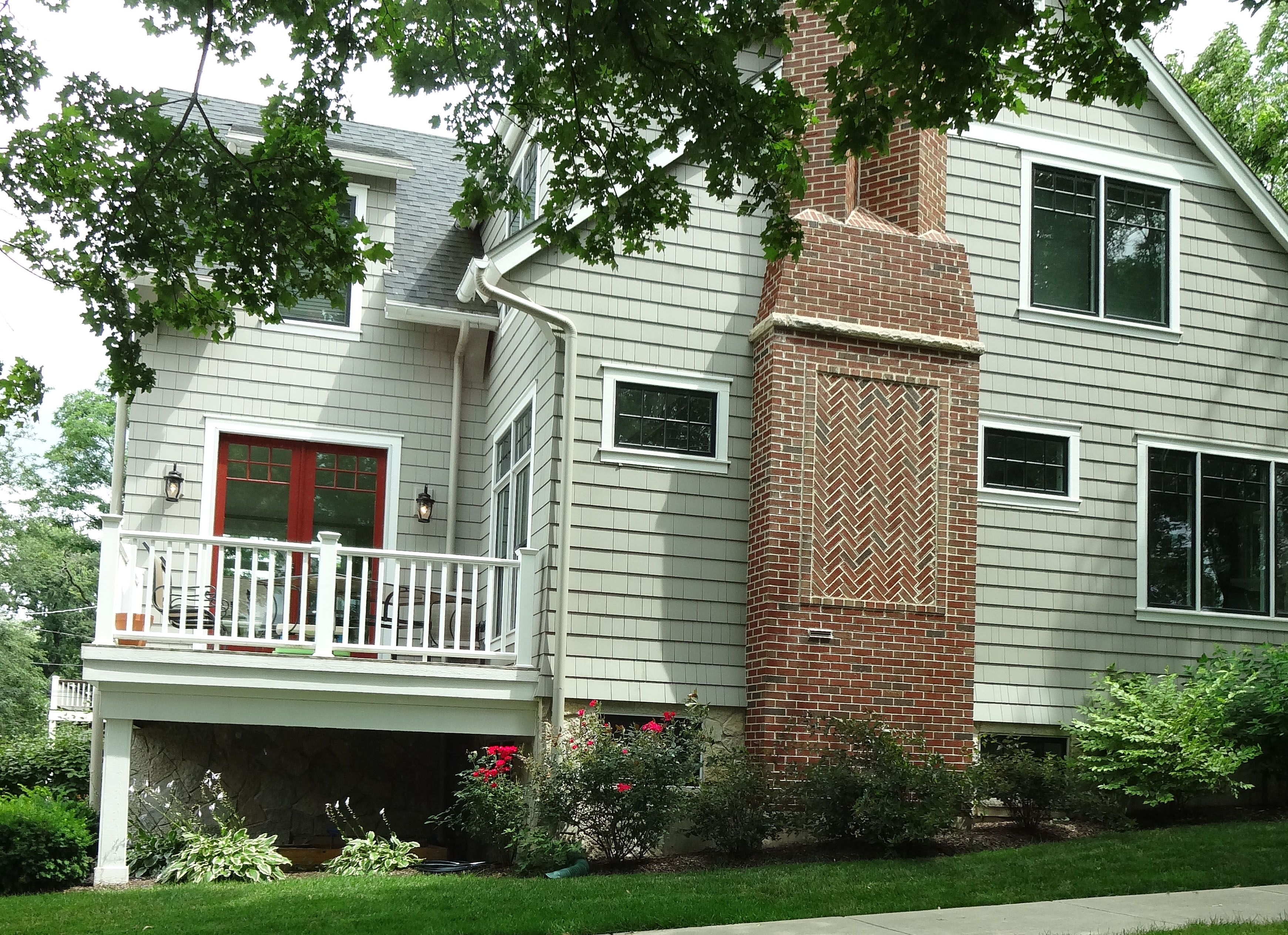 Earthy Green With Red Brick Not Christmassy As One Would Expect Green Siding Exterior Renovation Brick Chimney