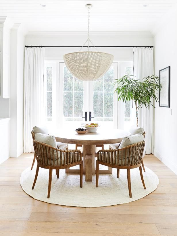 White Transitional Dining Room With Round Rug