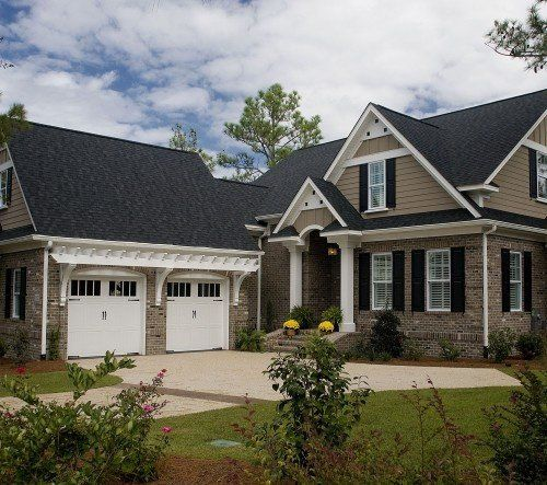 Exterior Colors Brick And Tan But With White Trim Windows Garage Doors With Windows And Brown House Exterior Exterior Paint Colors For House House Exterior