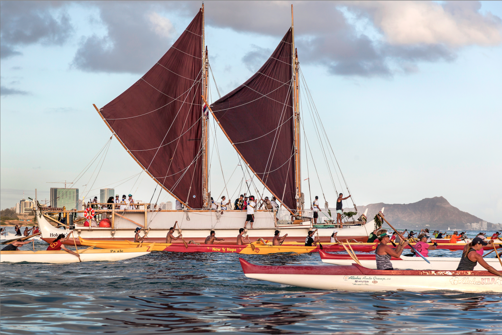 National Geographic: Hōkūleʻa: the Journey Begins ~ A fleet of paddling  canoes escorts Hōkūleʻa out of Honolulu. (Photo by Janet L.