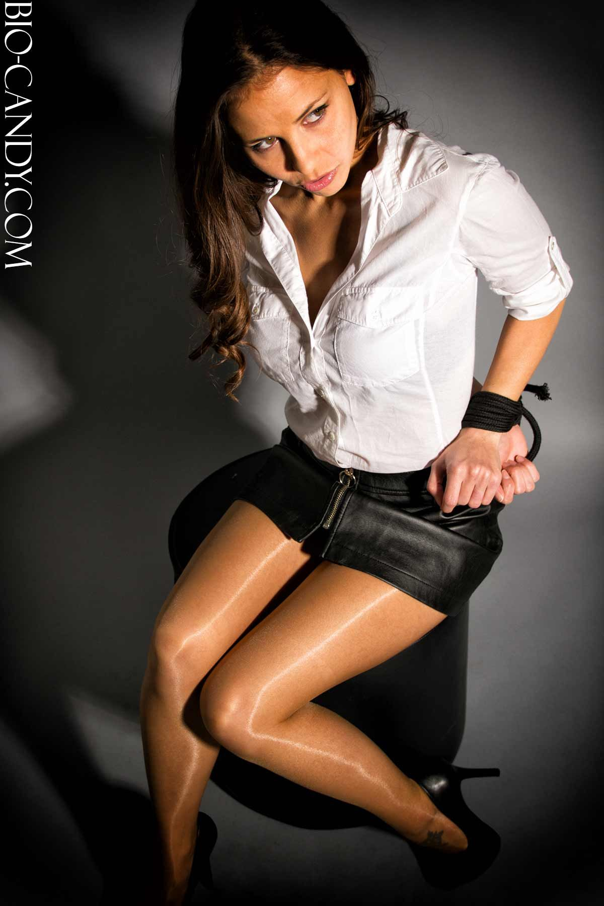 Cali Logan Bound In Leather Short Skirt And Shiny