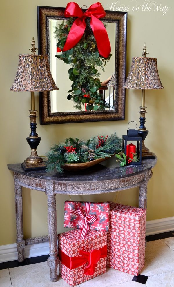 Dough bowl with greenery and bells; wrapped gifts under the table - christmas home decor