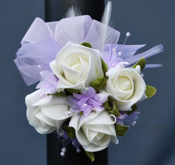 To make a long lasting wrist corsage glue the heads of fake flowers to make a long lasting wrist corsage glue the heads of fake flowers and bits of netting found in most fabric shops and small beads to a silk ribbon mightylinksfo