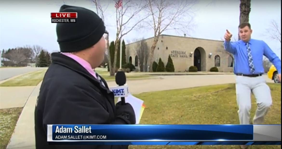 Adam Sallet was reporting live for KIMT News 3 in Rochester, Minnesota about a bank robbery when things got real. The news report starts as normal as any o