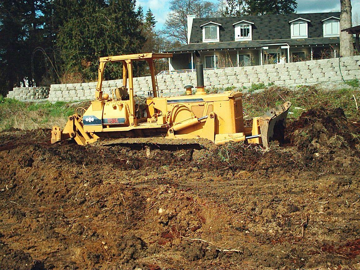 Stuck bulldozer in neighbors front flower(rose) garden. | car, truck ...