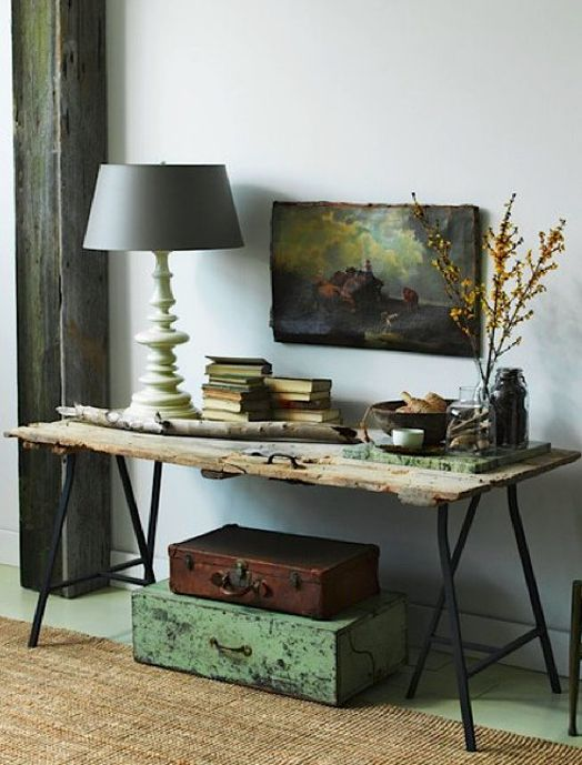 Nicely balanced use of old trestle, suitcases, op shop print and