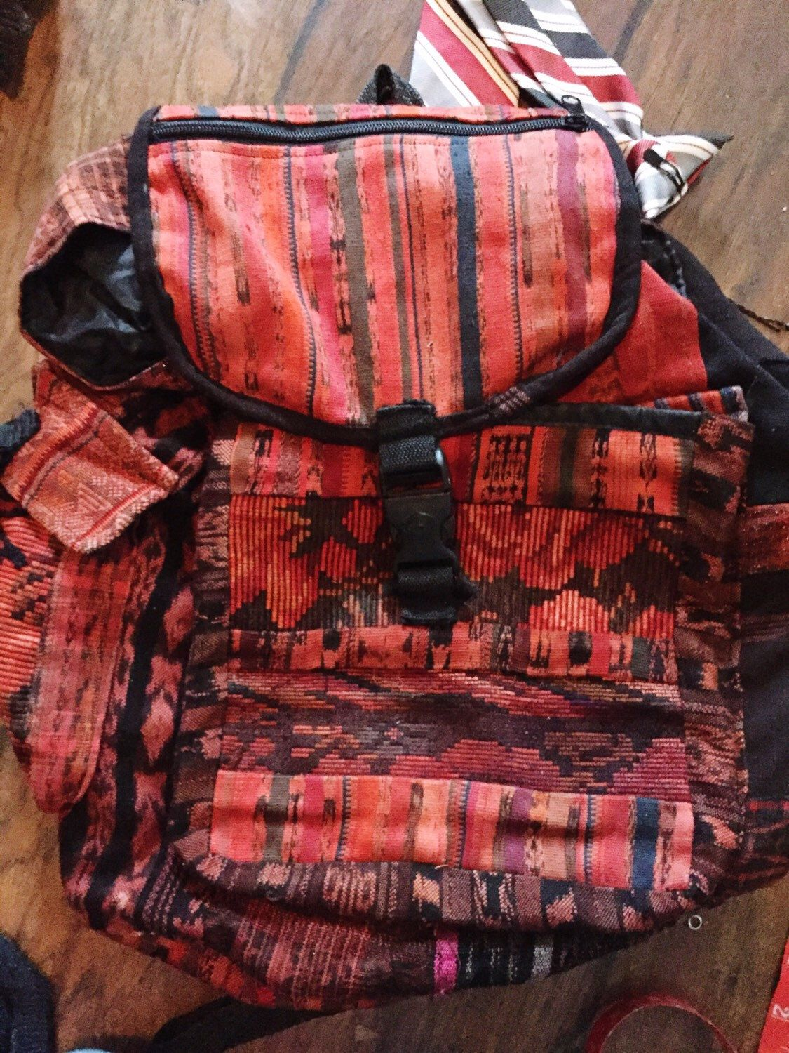 Unique boho hippie backpack red and black tribal patterened by OhmannSquiresCrafts on Etsy https://www.etsy.com/listing/286989825/unique-boho-hippie-backpack-red-and