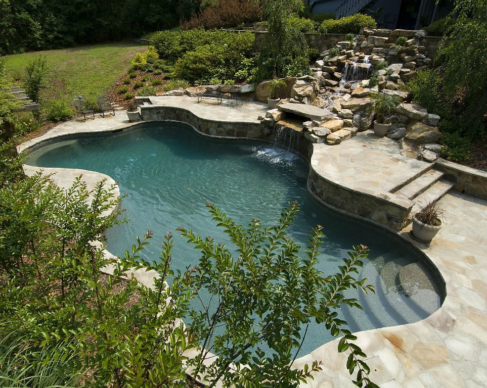 Free form residential pool with tiered waterfall by for Pool design usa