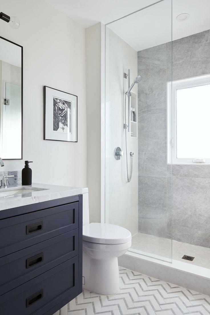 Glass Shower With Navy Blue Vanity And Chevron Tile Floor Bathroomfloor Blue Bathroom Vanity Bathroom Design Bathrooms Remodel