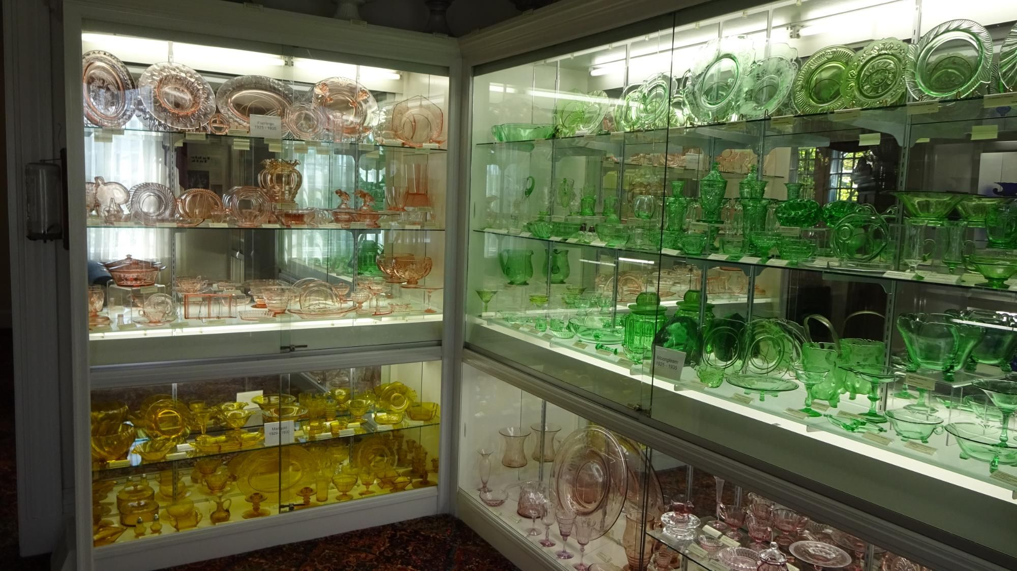 display of red, green, and yellow glass works
