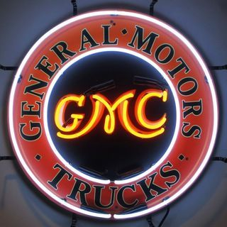GMC Trucks Neon Sign with Silkscreen Backing featuring multi-colored, hand blown neon tubing. The glass tubes are supported by a black finished metal grid which can be hung against a wall or window. I More
