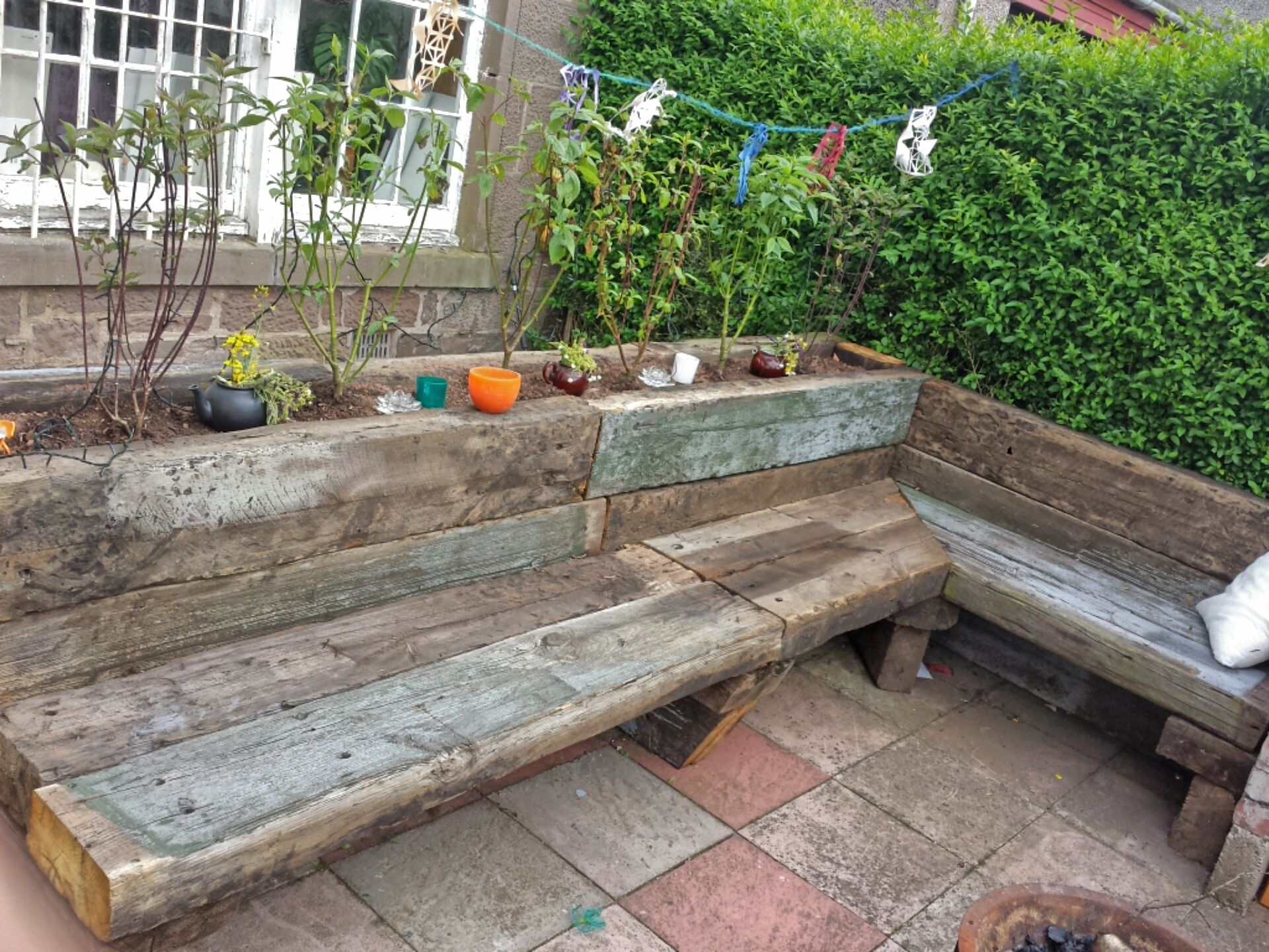 garden bench and planter made from old railway sleepers